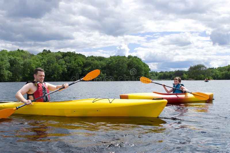 Father and son kayaking royalty free stock photos