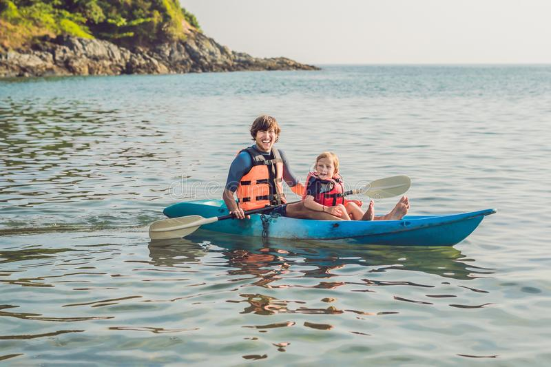 Father and son kayaking at tropical ocean. royalty free stock photography