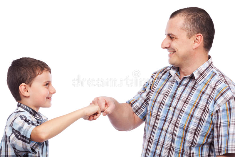 Father and son with a kind of high-five salute royalty free stock photography