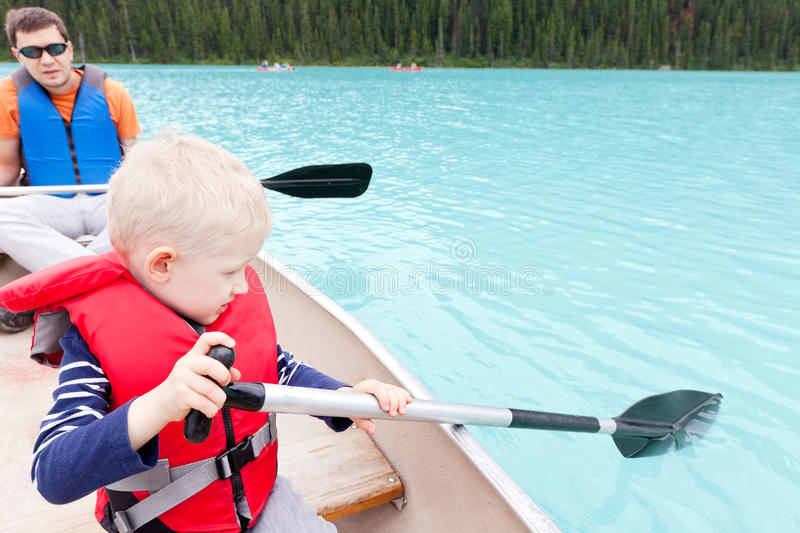 Download Father and son on a lake stock photo. Image of safe, activity - 27433608