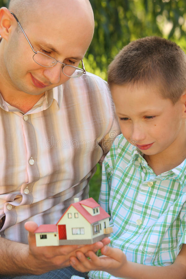 Father And Son Looking At Wendy House Stock Images