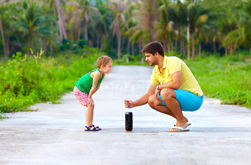 Father and son making chemical experiment, funny education. Outdoors stock photos