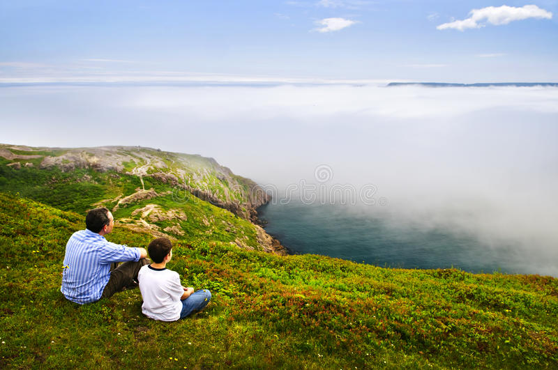 Father and son at ocean coast stock photo