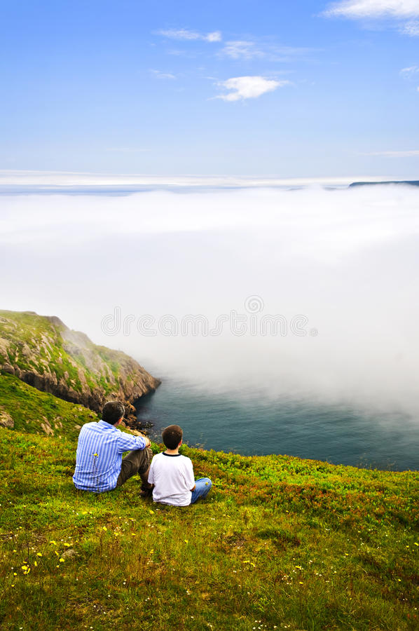 Father and son at ocean coast royalty free stock image