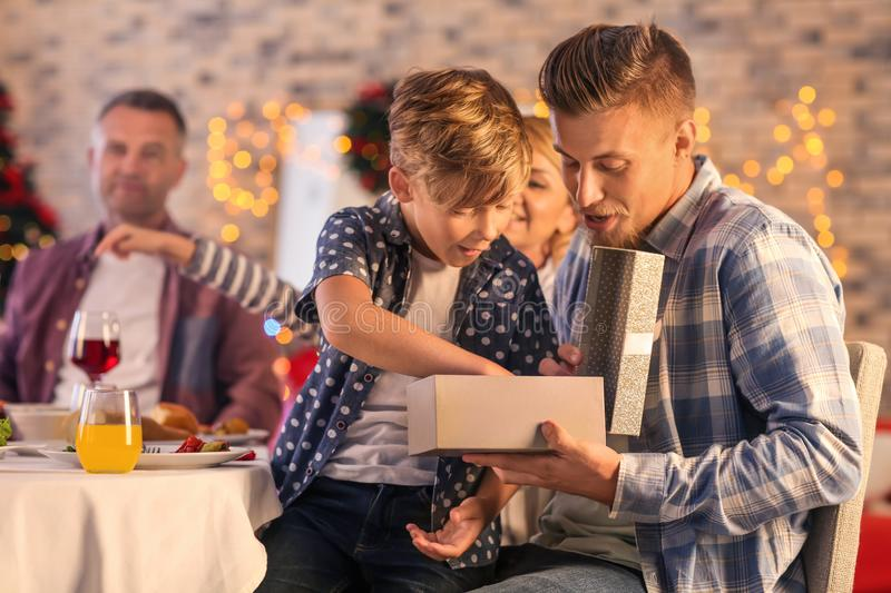 Father and son opening Christmas gift at home royalty free stock images
