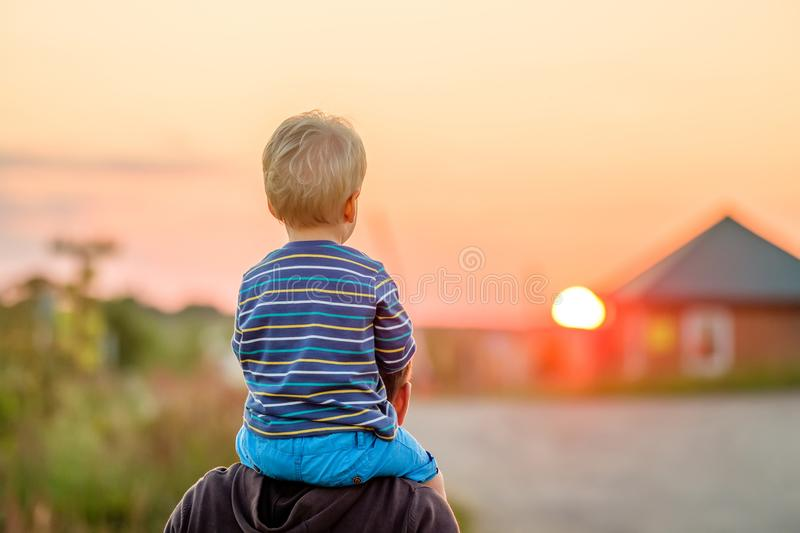 Download Father And Son Outdoor Portrait In Sunset Sunlight Stock Photo - Image of healthy, cute: 104626100