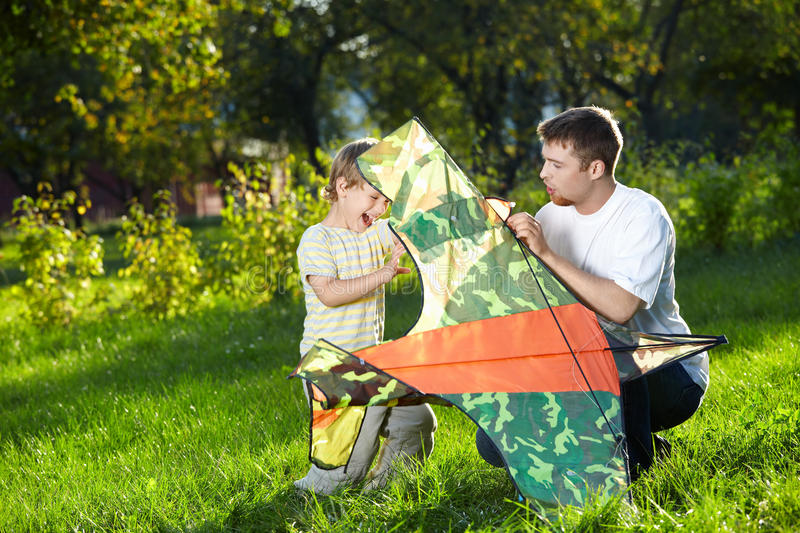 Download Father and son in park stock photo. Image of sunlight - 10972900