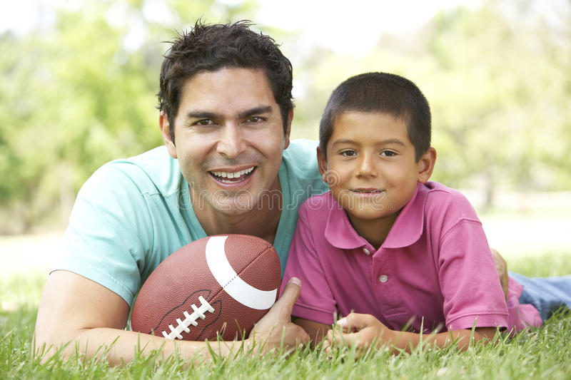 Download Father And Son In Park With American Football Stock Image - Image: 11502973
