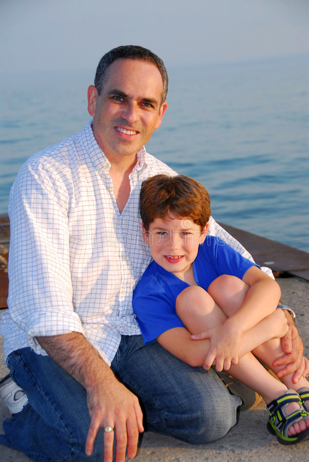 Father son pier royalty free stock photo