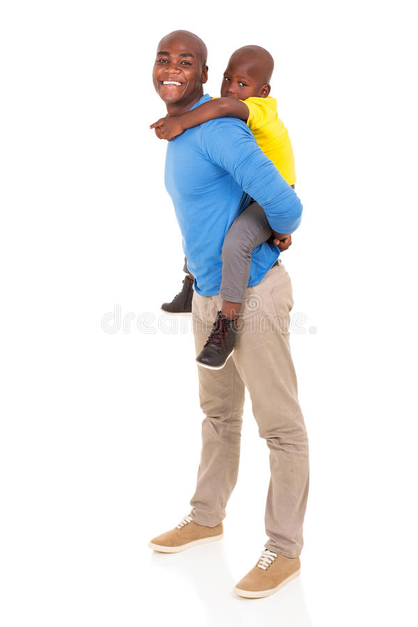Father son piggyback ride. African father giving his son piggyback ride on white background royalty free stock photos