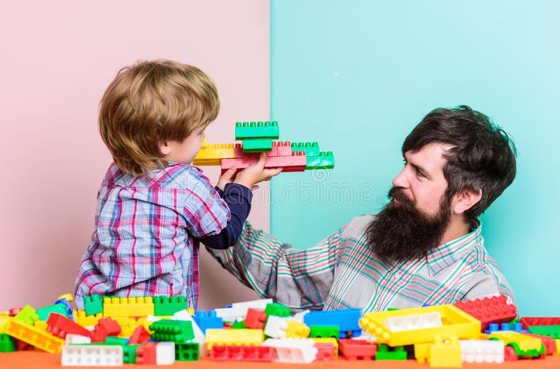 Father and son play game. Dream about fly. happy family leisure. building plane with colorful constructor. love. child stock photos