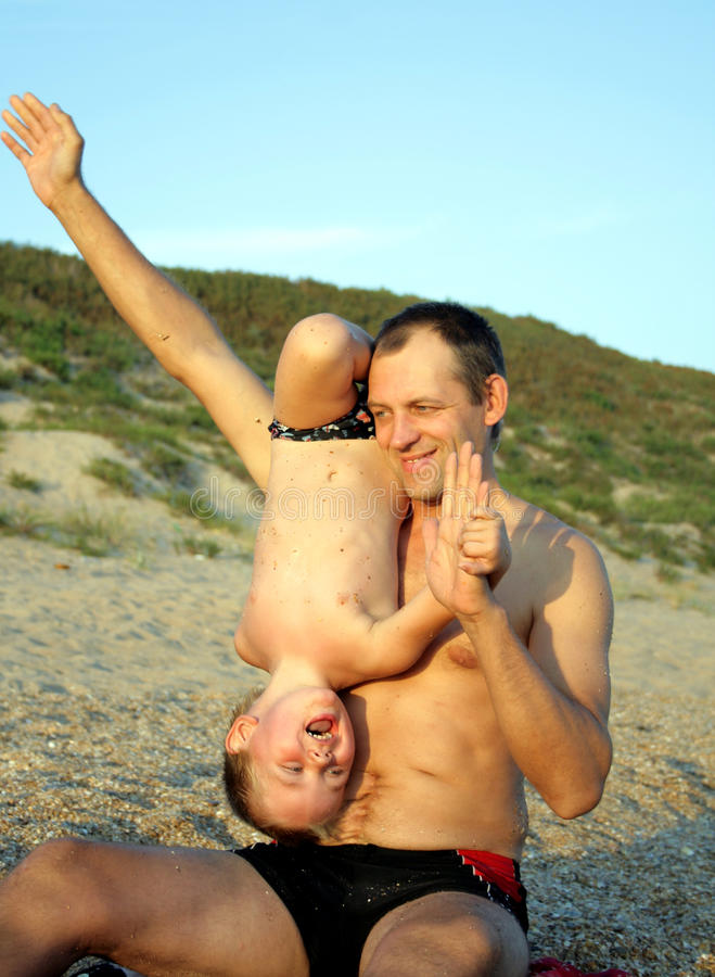 Download Father And Son Playing On The Beach Stock Image - Image: 10978497