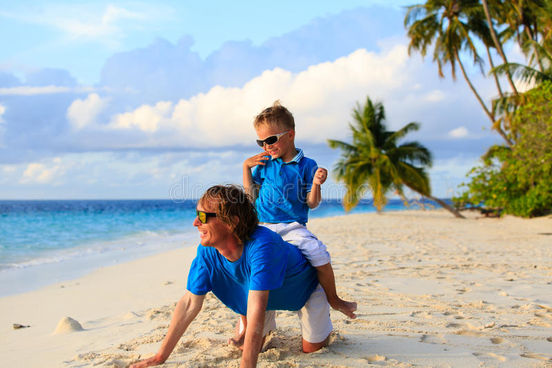 Father and son playing on beach. Family beach vacation royalty free stock photos