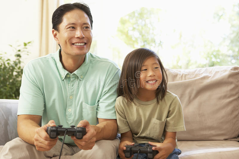 Father And Son Playing Computer Game At Home royalty free stock photos
