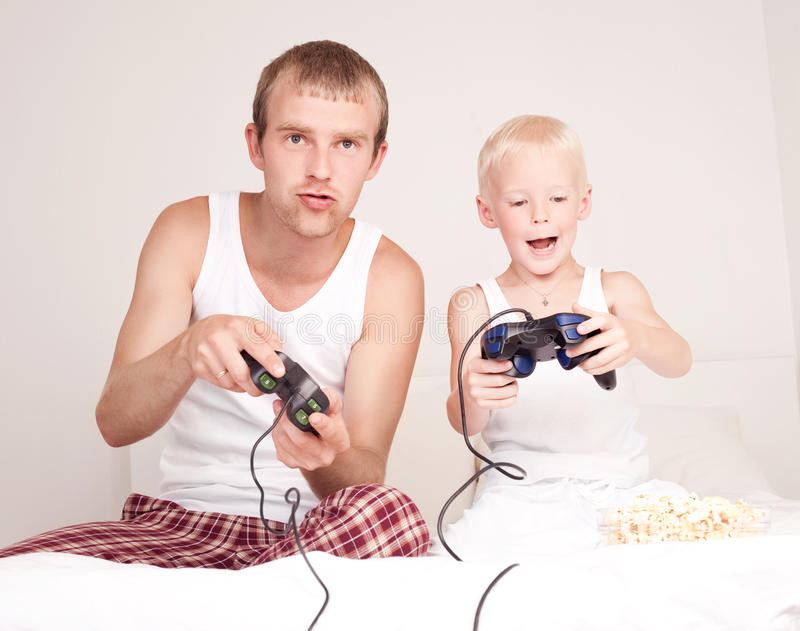 Download Father And Son Playing Games Stock Image - Image: 22954137