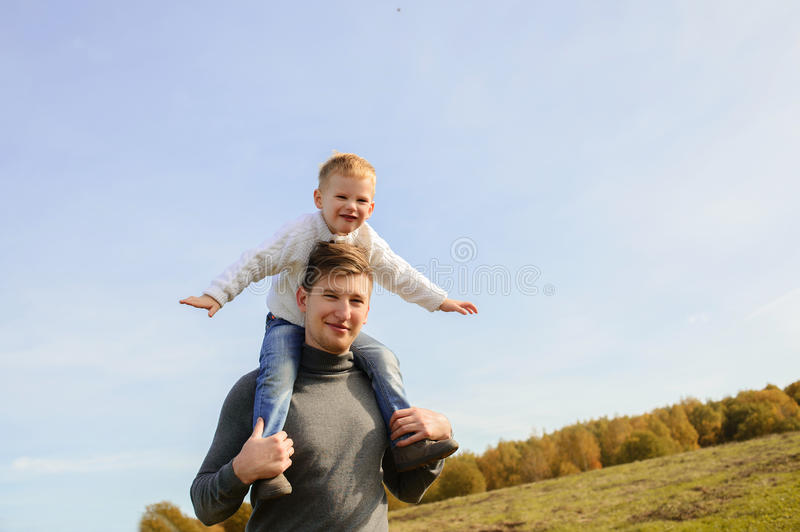 Father and son playing outdoors royalty free stock photo