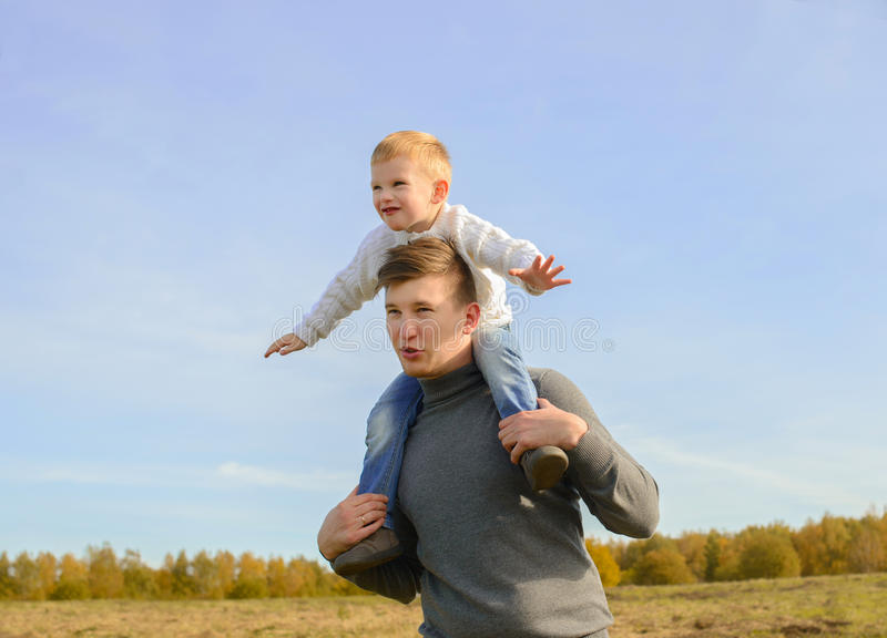 Father and son playing outdoors royalty free stock photography