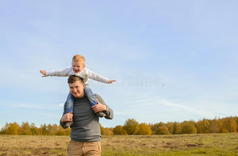 Father and son playing outdoors royalty free stock image
