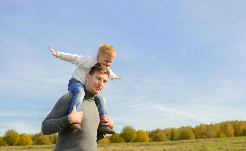 Father and son playing outdoors stock images