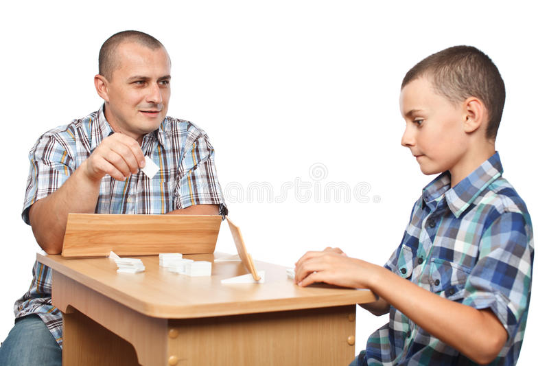 Father and son playing rummy royalty free stock images