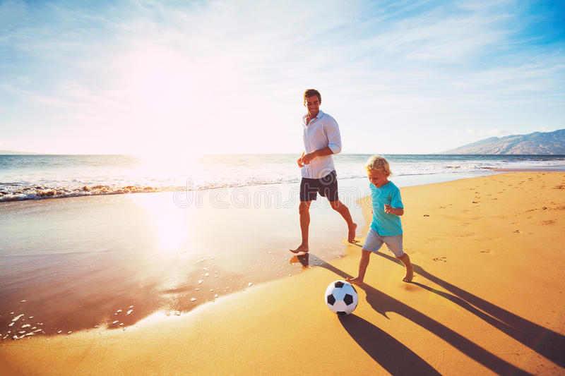 Father and Son Playing Soccer stock photography