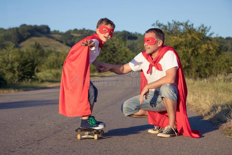 Father and son playing superhero at the day time royalty free stock photos
