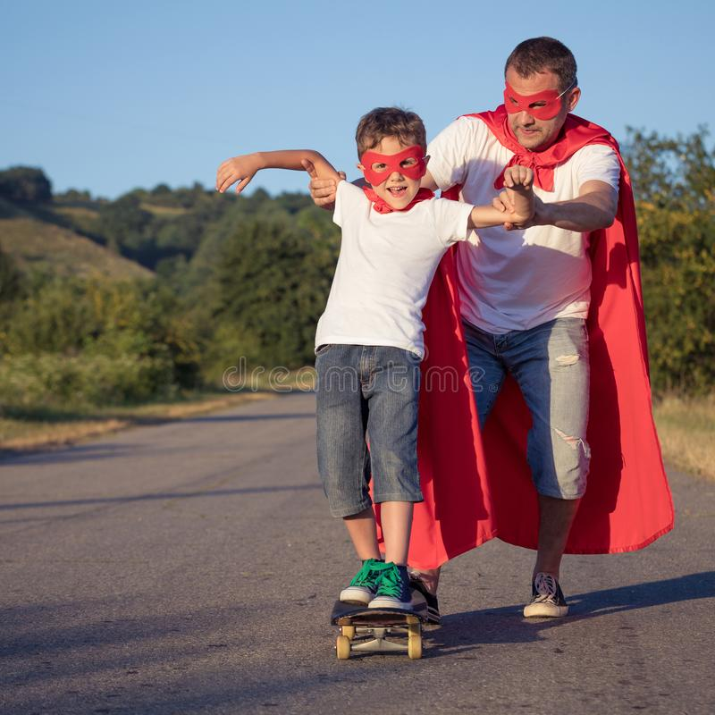 Father and son playing superhero at the day time royalty free stock photography
