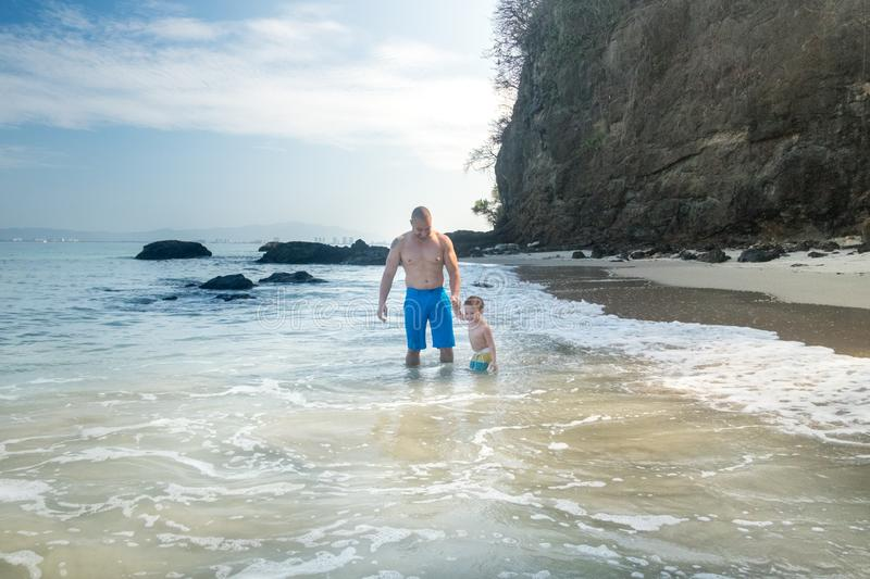 Father and son at Punta Negra Beach royalty free stock photo