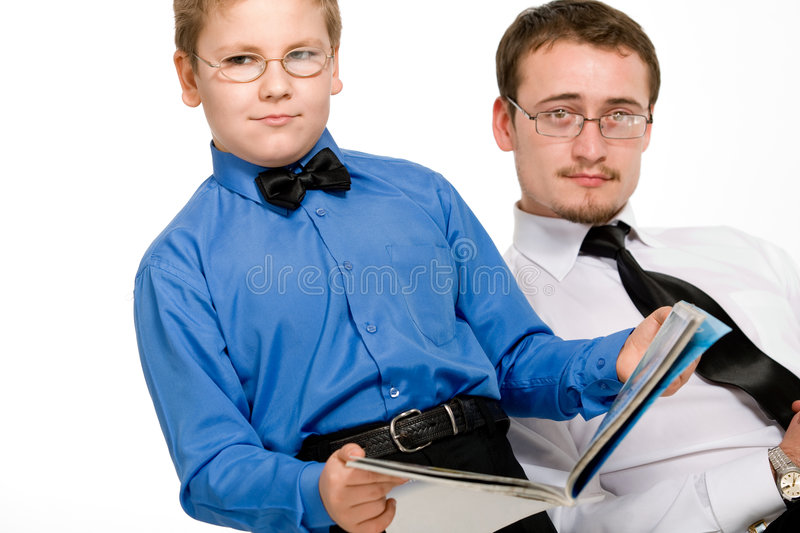 Father and son reading a magazine isolated royalty free stock photos