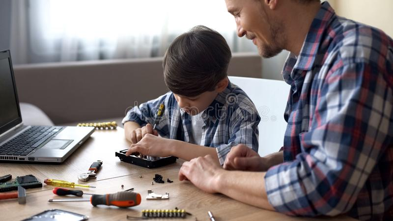 Father and son repairing small household appliances, support and reliance royalty free stock images