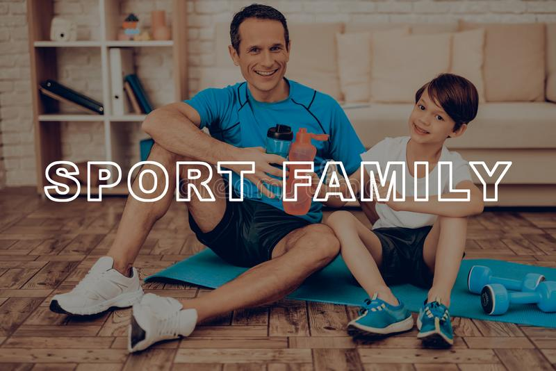 Father And Son Are Resting On The Gym Carpet. Healthy Lifestyle. Active Holiday. Sports Clothes. Working Out At Home. Bottles Of Water. Body Exercises. Family stock photos