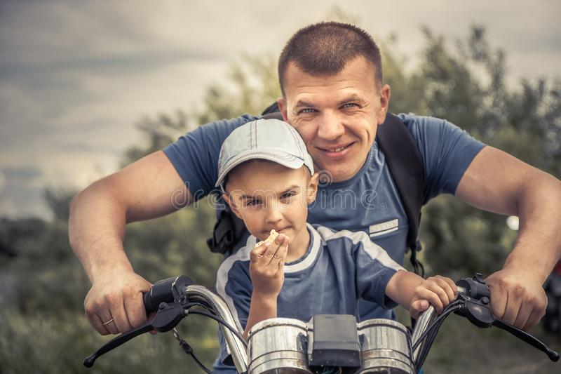 Father son riding motorcycle lifestyle biker portrait concept happy paternity father's day royalty free stock images