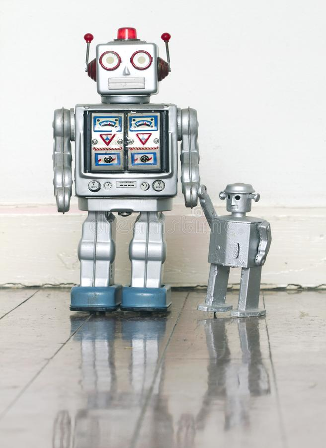 Father and son robot toys royalty free stock photography