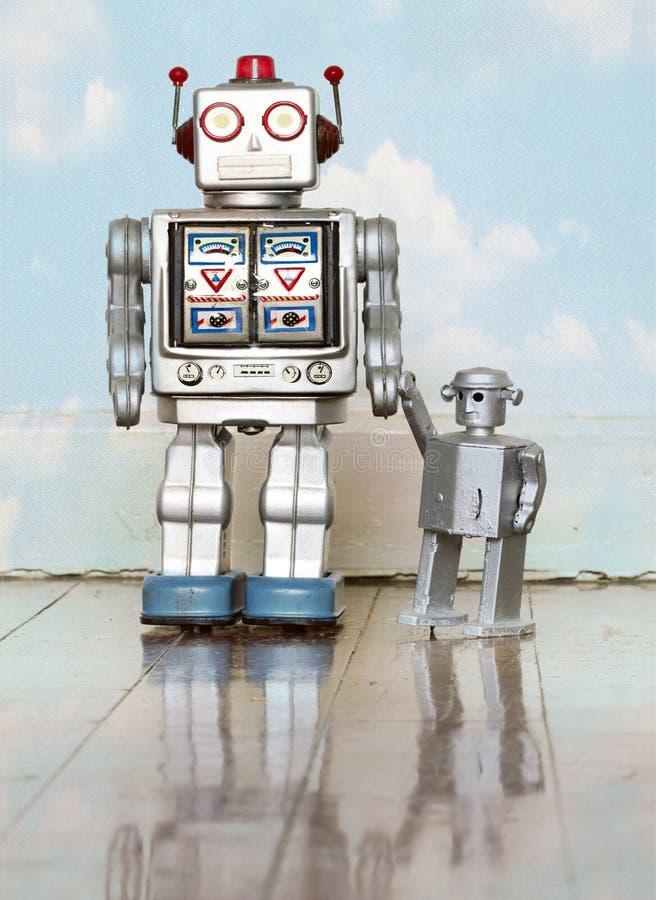 Father and son robot toys royalty free stock photos