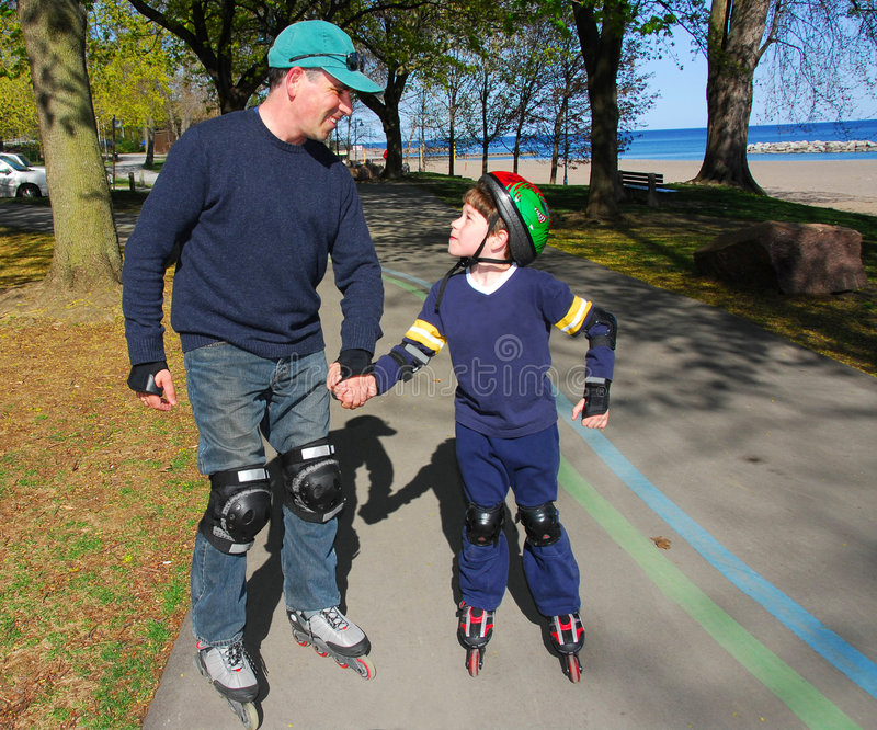 Father son rollerblade stock image