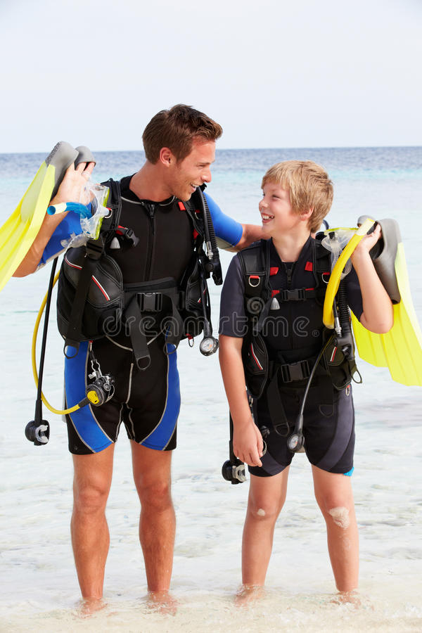 Father And Son With Scuba Diving Equipment On Beach Holiday stock image