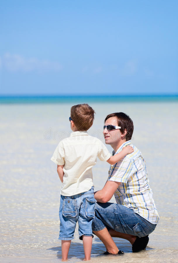 Download Father And Son At Shallow Water Stock Photo - Image of child, ocean: 20236116