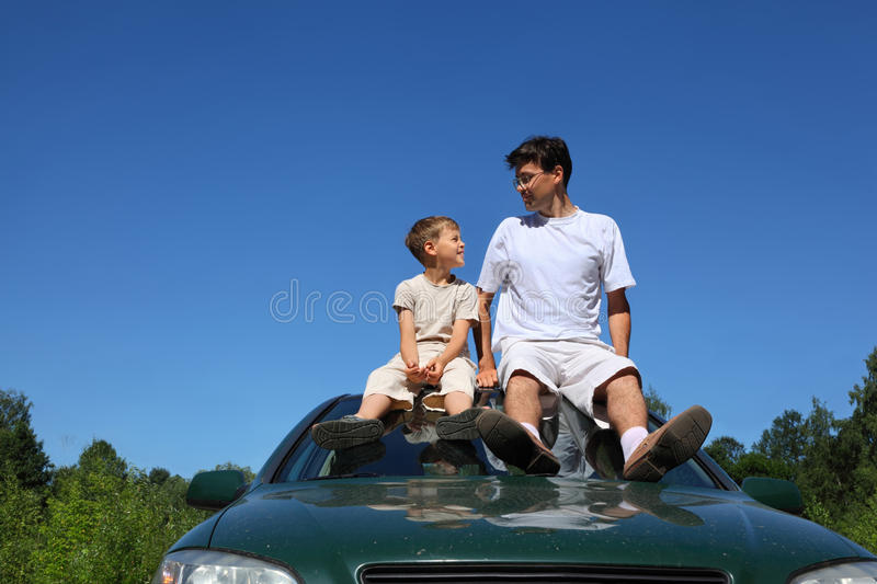 Download Father And Son Sit On Roof Of Car In Day Stock Image - Image: 18361195