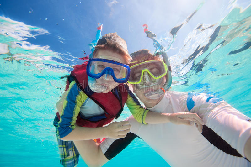 Father and son snorkeling royalty free stock photography