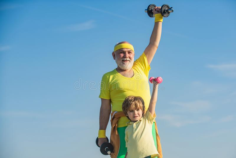 Father and son spotting. Sport and training concepts. Sports for kids. Follow grandfather. Father and child training royalty free stock image