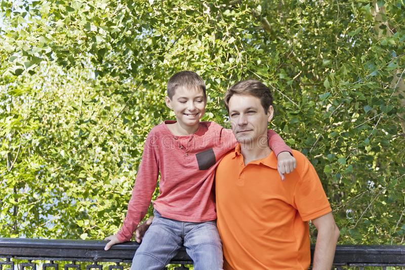 Father and teenager son together royalty free stock photography