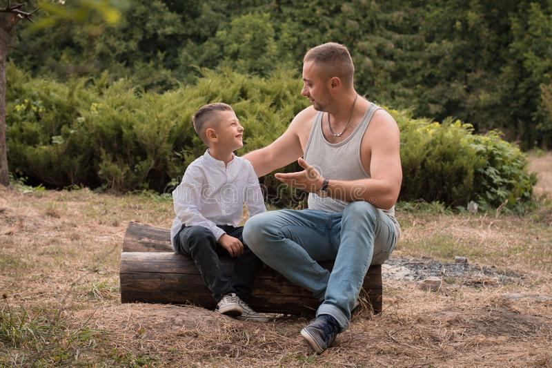 Father and son are talking royalty free stock photography