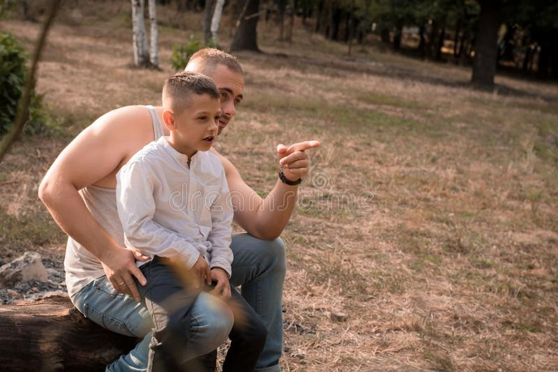 Father and son are talking royalty free stock images