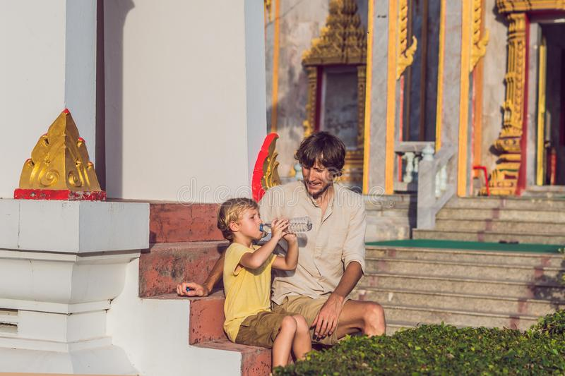 Father and son tourists look at Wat Chalong is the most important temple of Phuket stock image