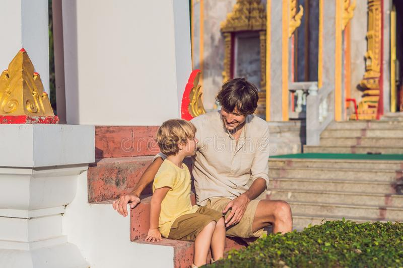 Father and son tourists look at Wat Chalong is the most important temple of Phuket royalty free stock image