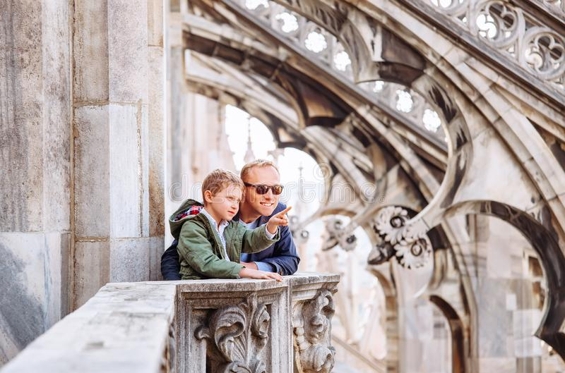 Father with son tourists are on the roof of Milan Cathedral stock photography