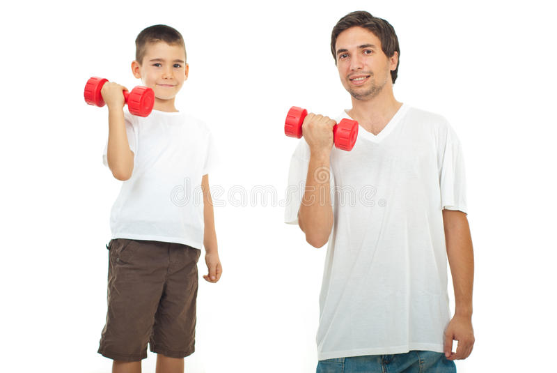 Father and son training with dumbbell stock photography