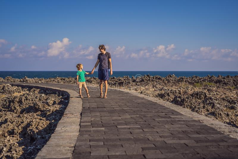 Father and son travelers on amazing Nusadua, Waterbloom Fountain, Bali Island Indonesia. Traveling with kids concept.  royalty free stock images