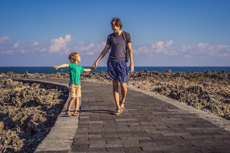 Father and son travelers on amazing Nusadua, Waterbloom Fountain, Bali Island Indonesia. Traveling with kids concept.  stock images