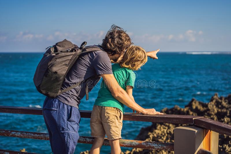 Father and son travelers on amazing Nusadua, Waterbloom Fountain, Bali Island Indonesia. Traveling with kids concept.  stock photos